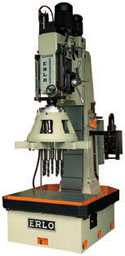 Erlo production drill press with multi spindle head and automatic cycles.