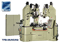 Erlo custom designed multi spindle drill press with indexing table.